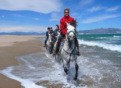 Horseback riding on the beach in Spain